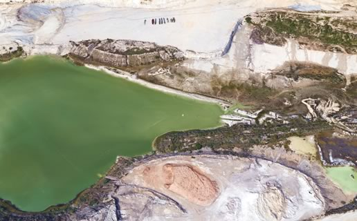 Polluted water at site of rock quarry near Comal County