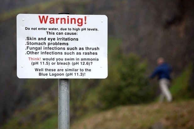 Warning sign posted near former rock quarry