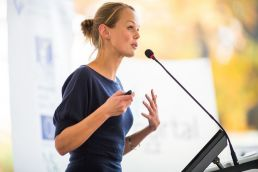 Woman speaking at public meeting