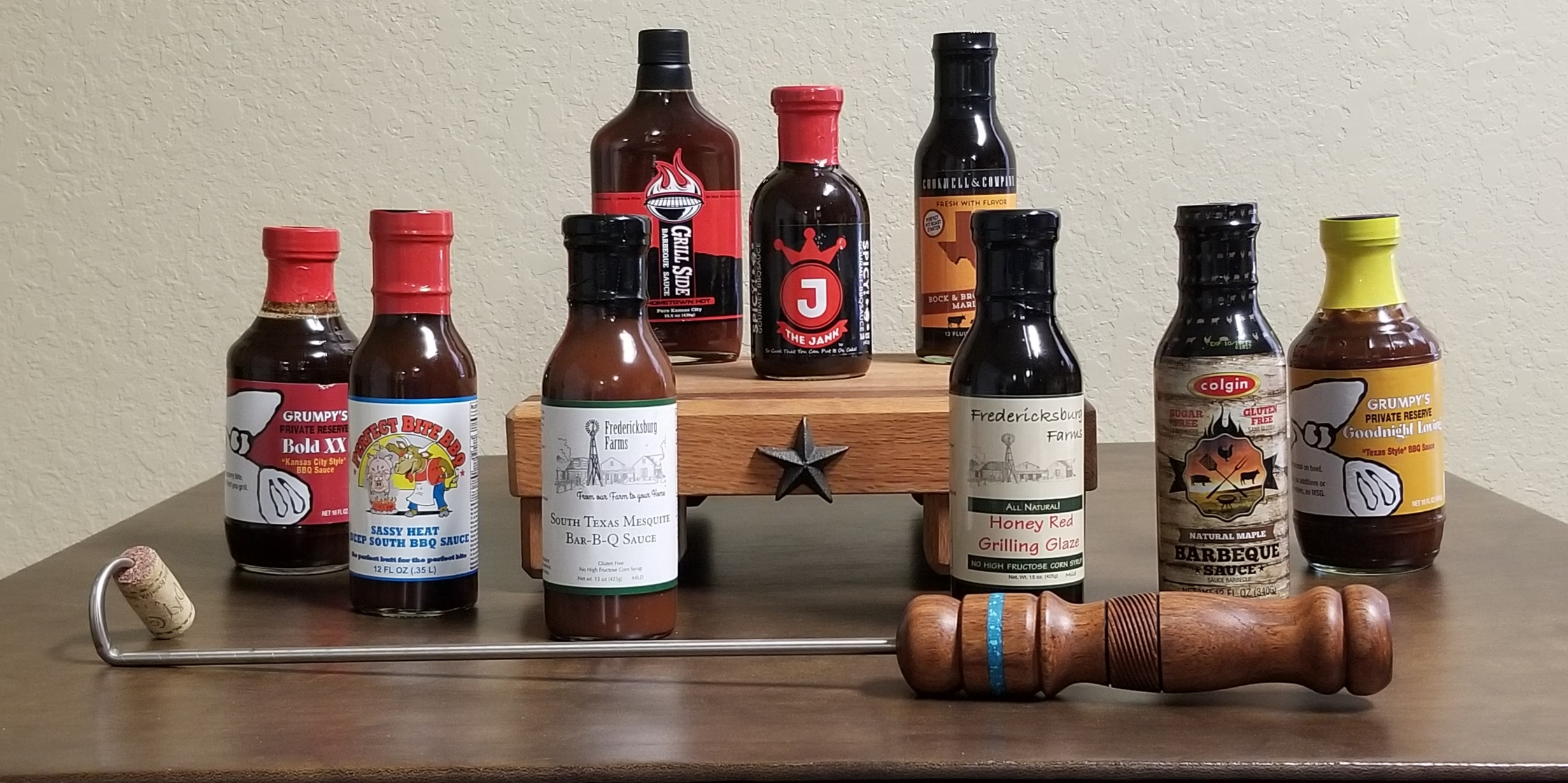 Online Secret Bid Auction Item: Homestyle Bar-B-Que: Artisan handmade pigtail meat flipper w/mesquite wood handle, wood cutting board, sauces & marinades