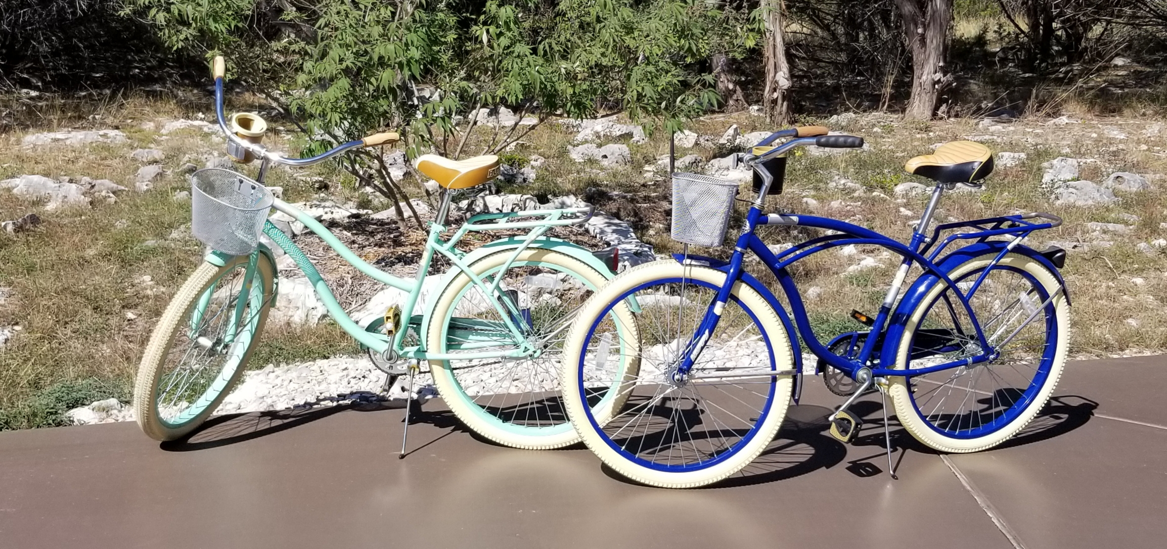 "Online Secret Auction: Pedal Pushers Delight: Huffy 26"" Deluxe Cruiser Bikes (like new) w/cupholders, front basket, and adjustable rear rack. Men's (dark blue), Women's (Mint Green)"